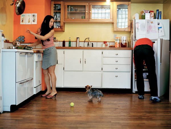 Young couple with dog in kitchen, Brooklyn New York by Sherrie Nickol
