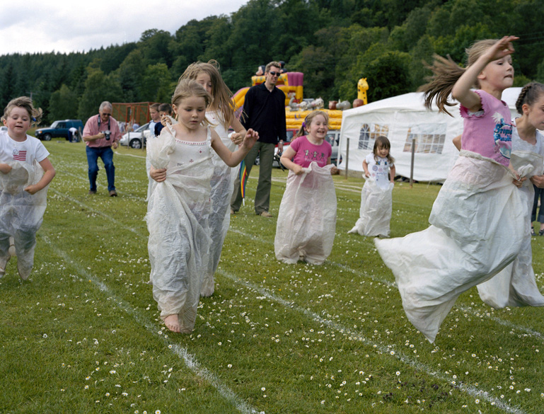 Children competing in sack race at county fair - photograph by Sherrie Nickol