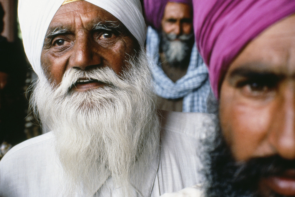 Portrait of three Sikh men - Red Fort, Old Delhi India - photograph by David Katzenstein