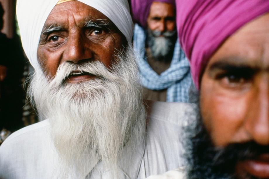 Portrait of three Sikh men - Red Fort, Old Delhi India - photograph by David Katzenstein